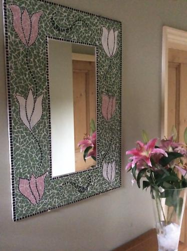 Mirror frame with tulip design